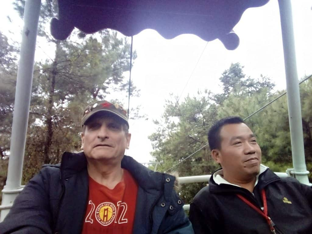 """""""Going up."""" With my guide, Eric as we head up Yao Mountain."""