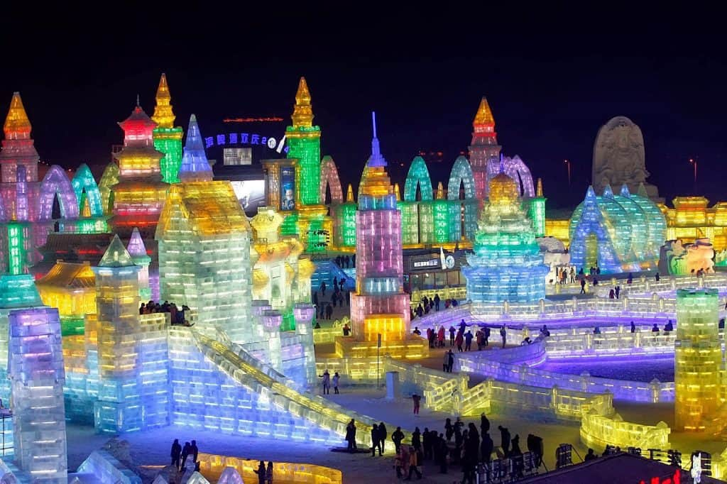 Next stop: Harbin, January 28 to attend the Harbin Ice Festival shown here. Those aren't material structures; they're made of ice. How cool is that?